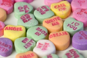 So much romance! So much mystery! All stamped on candies that taste like Pepto tablets.